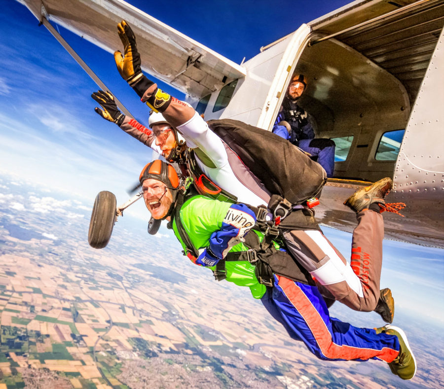man goes skydiving for charity